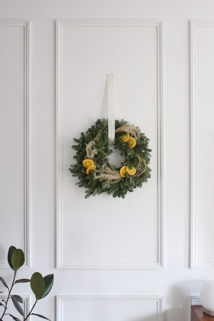 Christmas spruce wreath with oranges and pampas grass