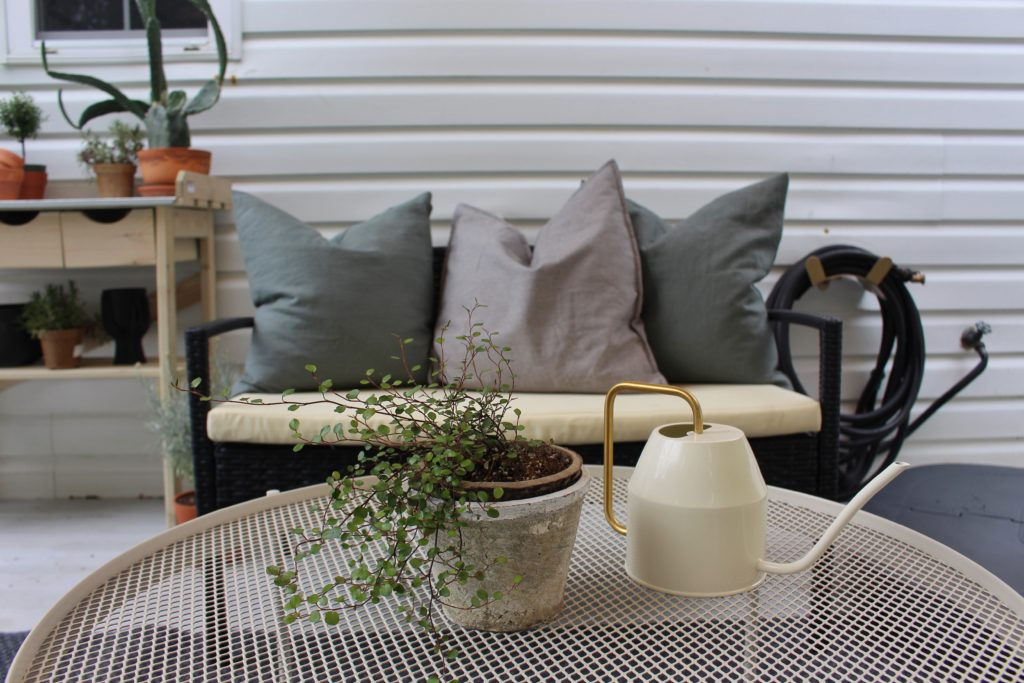 IKEA coffee table with plants and view of pillows